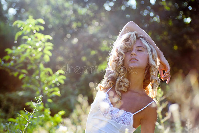 Girl relaxing on green grass in summer day royalty free stock photos