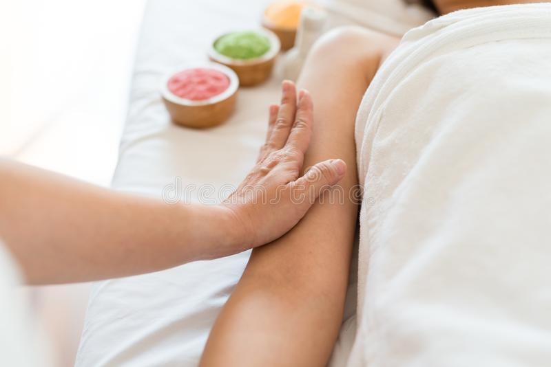 Girl relaxing having arm massage in a spa salon, close up royalty free stock images