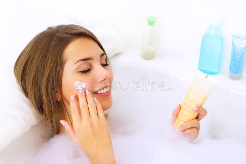 Girl relaxing in her bathtub. Attractive girl relaxing in her bathtub stock photography
