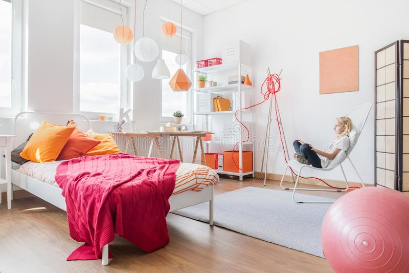 Girl relaxing in her bedroom stock photography