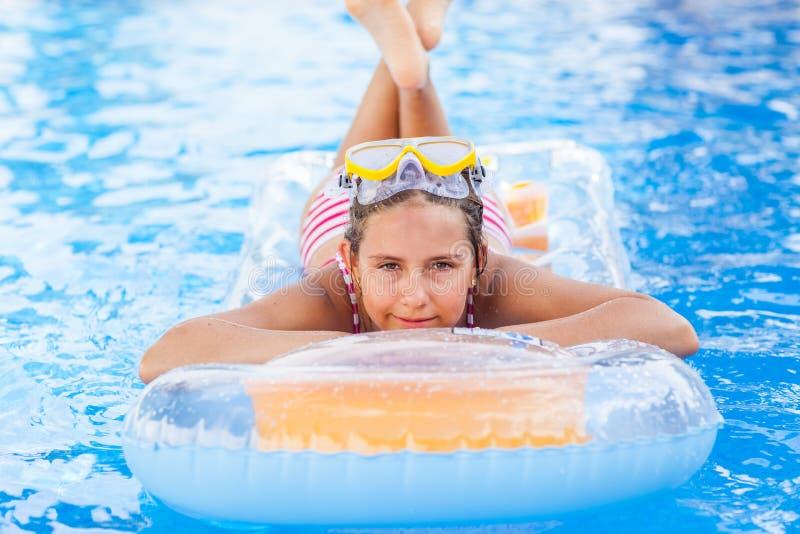 Girl relaxing in pool stock photos