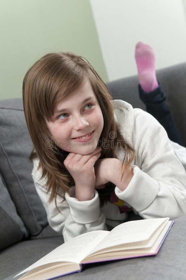 Download Girl relaxing and reading stock image. Image of lying - 13437109