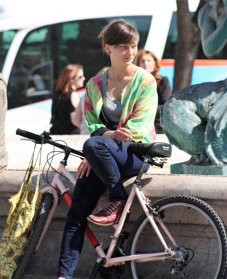 Girl relaxing after a ride, Lisbon stock image