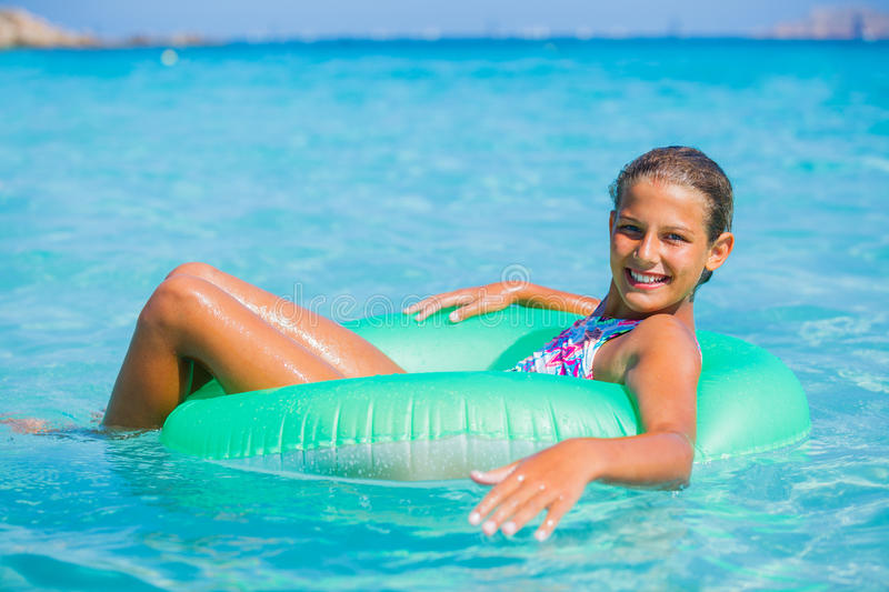 Girl relaxing in the sea royalty free stock photo