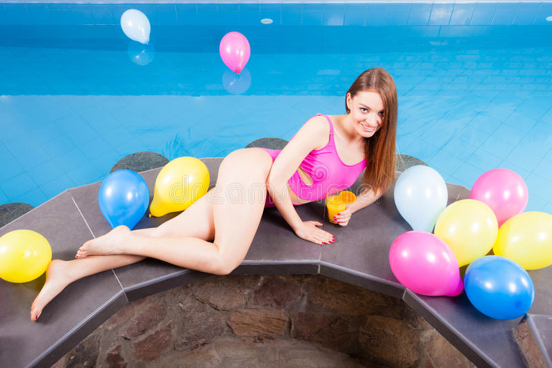 Girl relaxing at swimming pool with drink royalty free stock photos