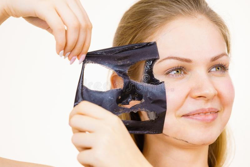 Girl removes black mask from face stock photos