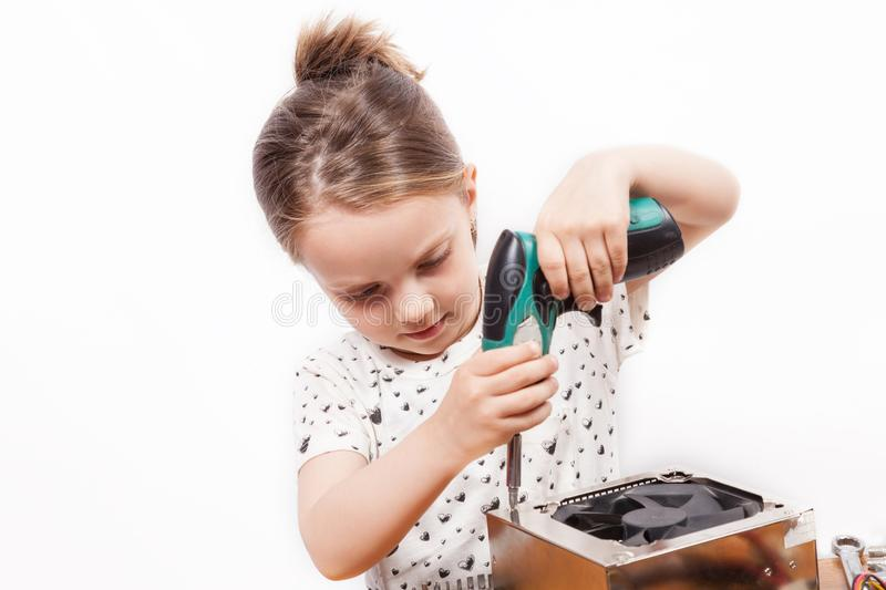 Girl while repairing components of a PC. Girl who repairing components of a PC royalty free stock images
