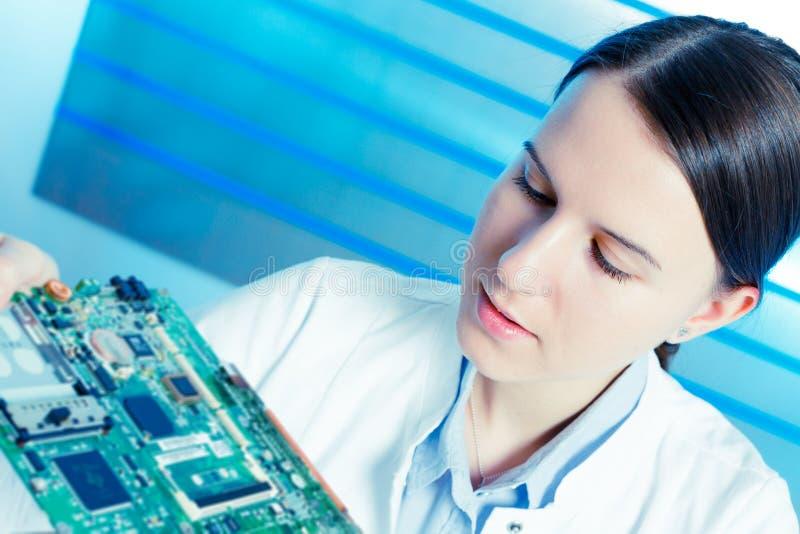 Girl repairing electronic device stock photo