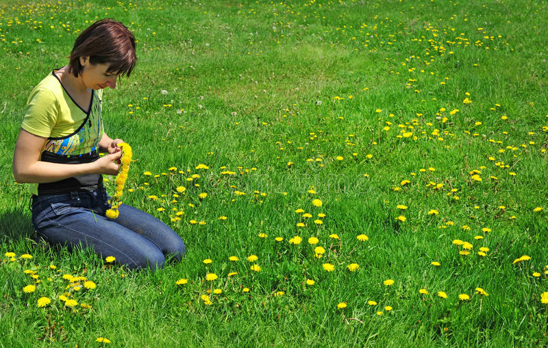 Girl resting on the green meadow stock photo