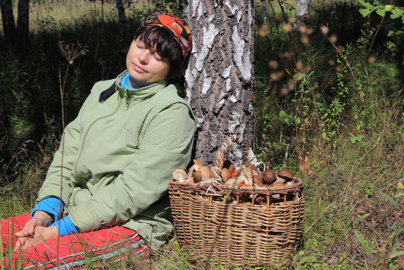 Girl resting after mushroom stock photos