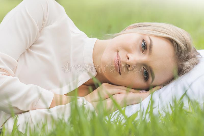 Girl resting on soft pillow royalty free stock image