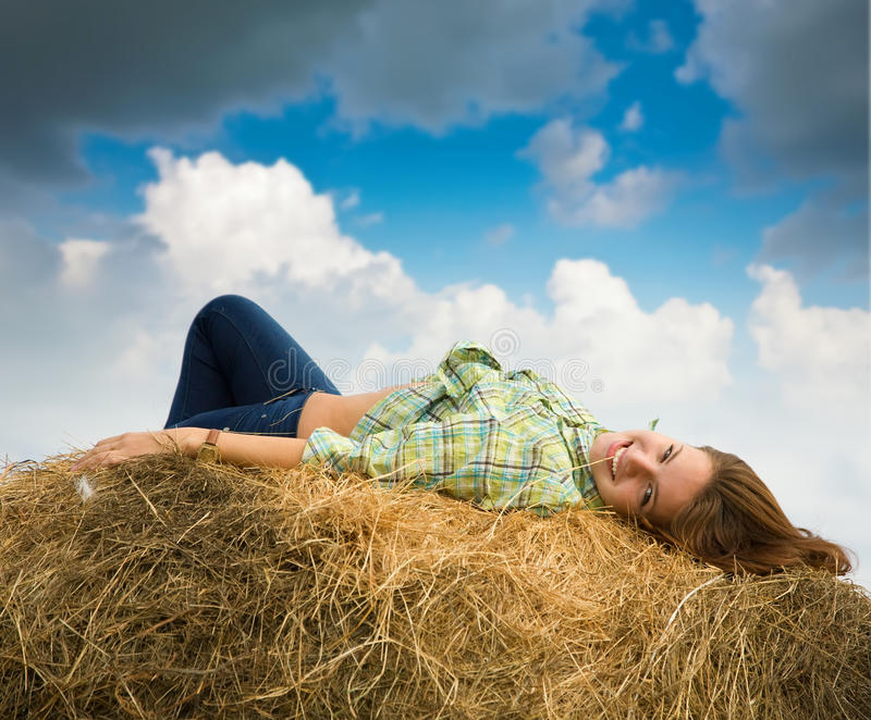 Download Girl  Resting On Straw Bale Stock Photo - Image: 16088162