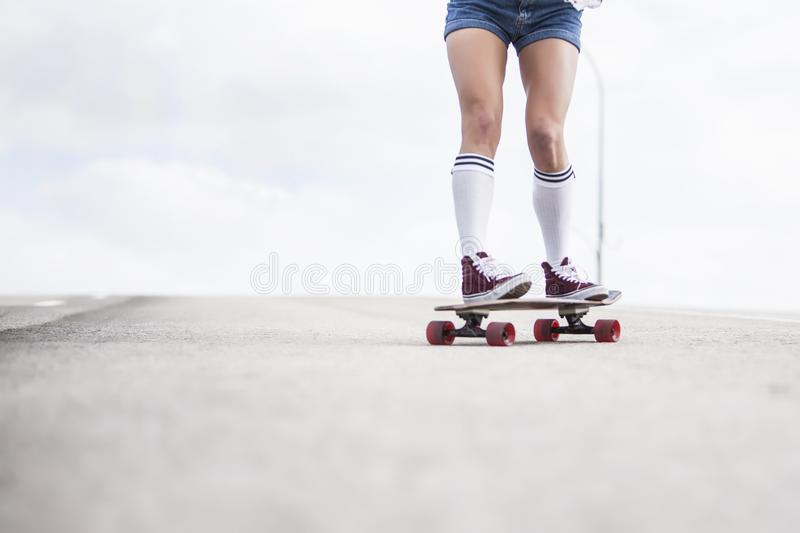 Girl rider long board stock images