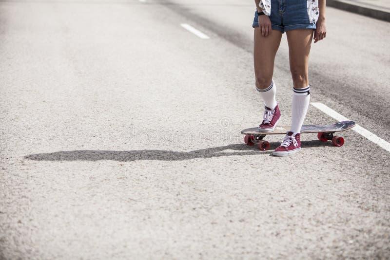 Girl rider long board stock photo