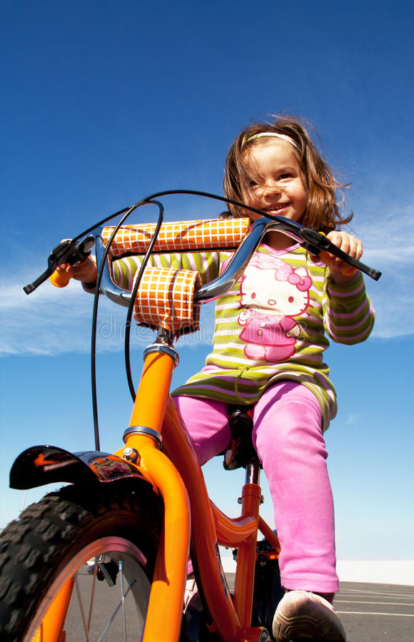 Girl Riding A Bicycle Editorial Stock Photo