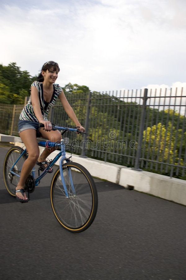 Girl Riding A Bike Stock Photo