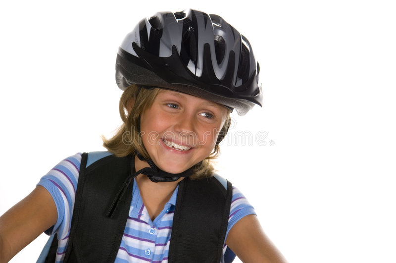 Girl riding Bike to School. Young girl getting ready to ride bike to school stock photos