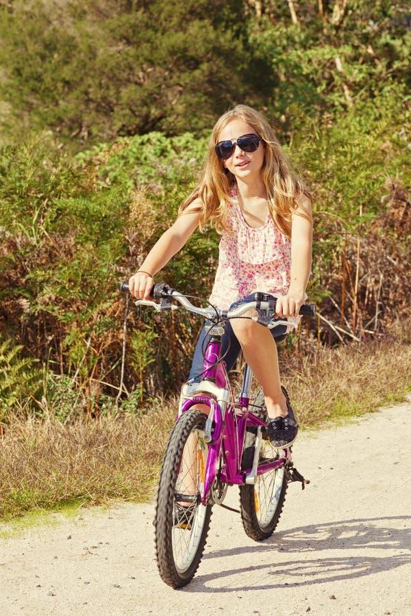 Girl riding bike stock images