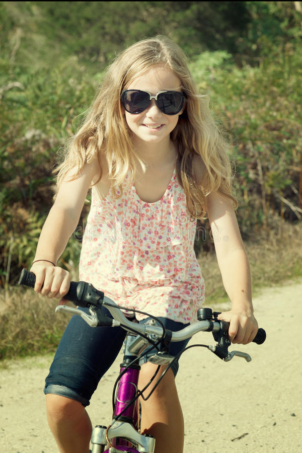 Girl riding bike stock image