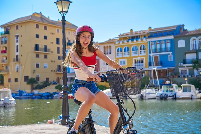Girl riding a foldable e-bike in a Port royalty free stock photography