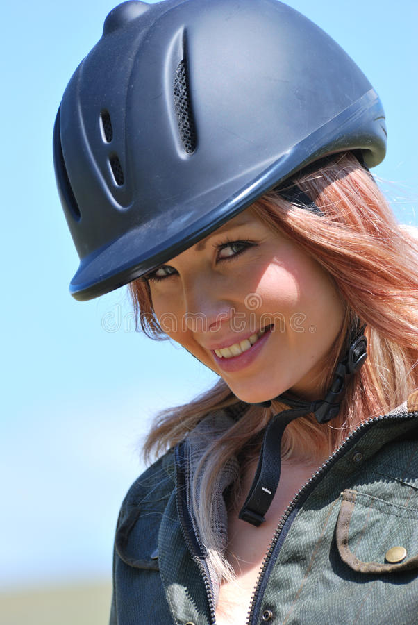 Girl in riding helmet stock photography