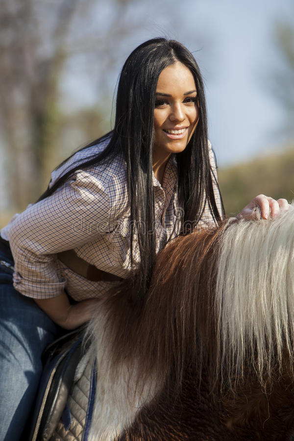 Girl riding on the horse. Young girl riding on the horse royalty free stock photo