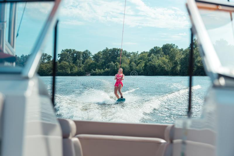 Girl riding a wakeboard on a local river stock images