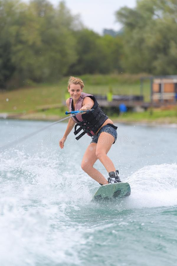 Girl riding on wakeboarding stock photos