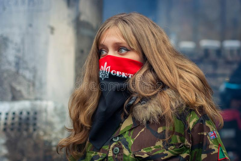 A girl from the right sector during demonstrations on EuroMaidan. Kiev stock images