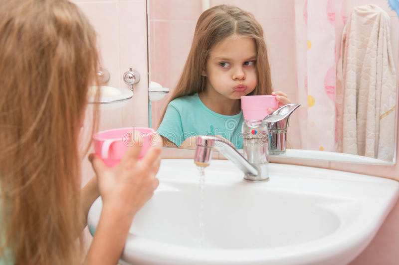 Girl rinse your mouth after brushing stock photography
