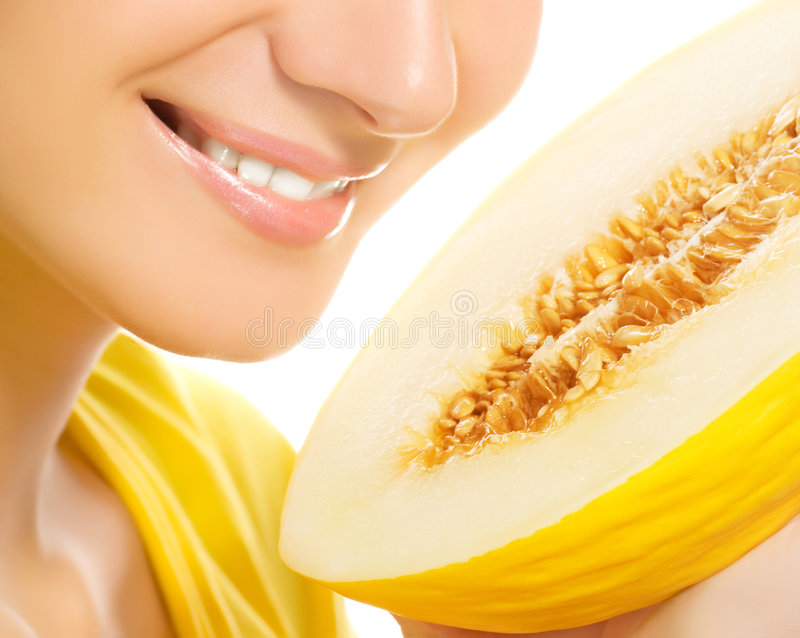 Girl with ripe melon stock photos