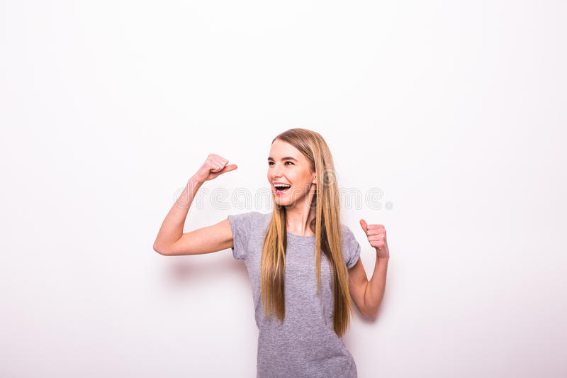 Girl with rised hands for victory gesture. Happy girl with rised hands for victory gesture stock photo