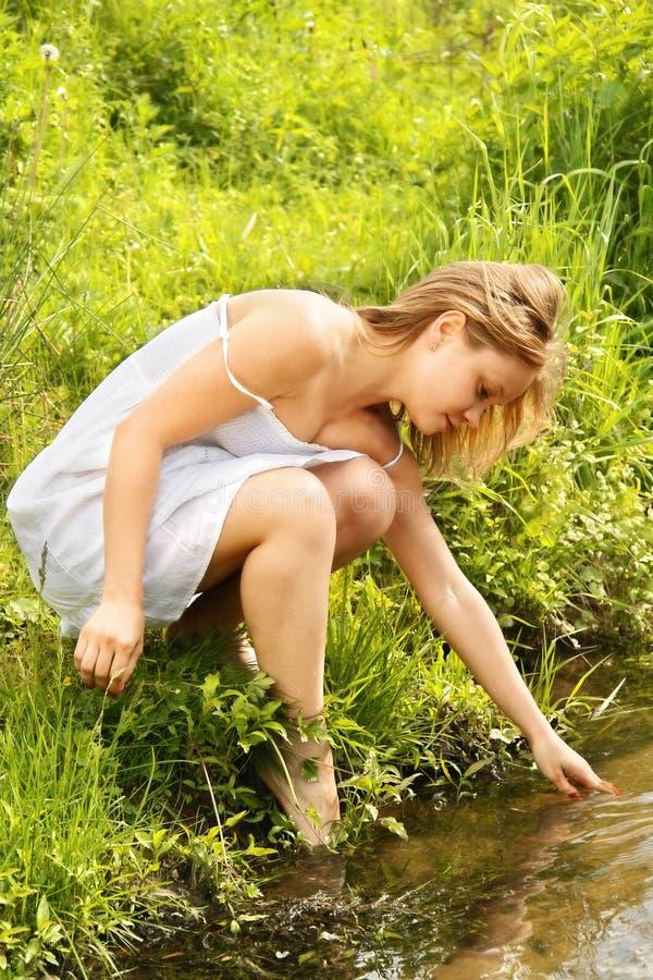 Girl at river royalty free stock photos