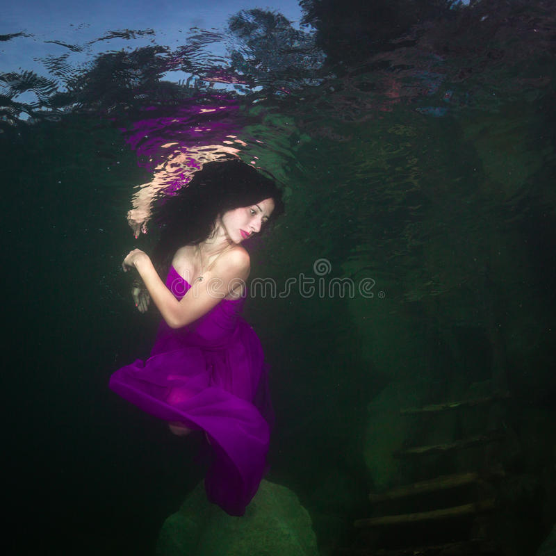 Girl in a river royalty free stock image