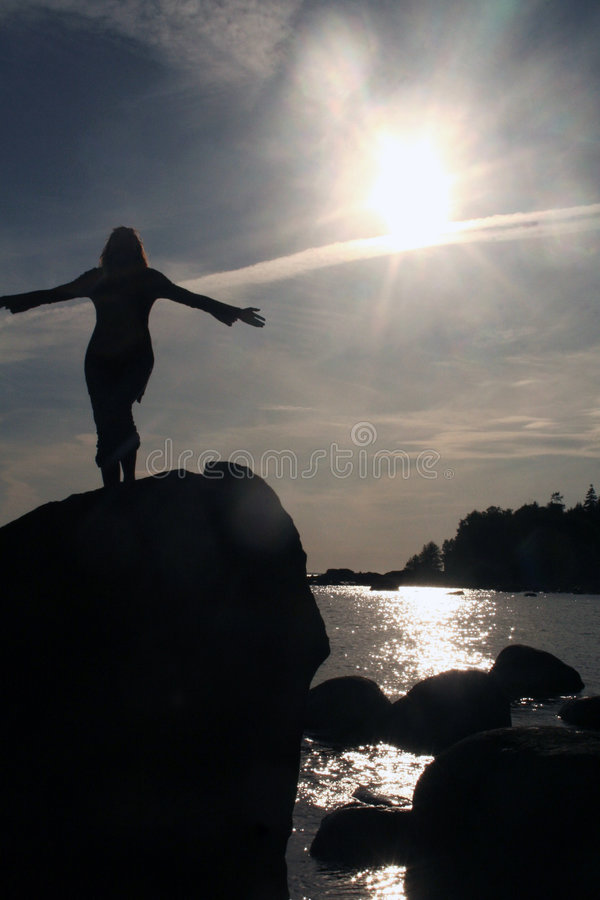 A girl on the rock royalty free stock photos