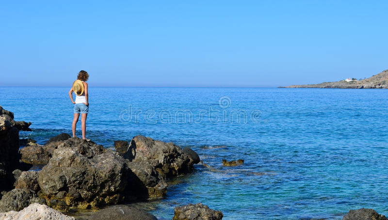 Girl on the rock royalty free stock photography