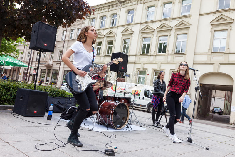 Girl rock band performing stock photography