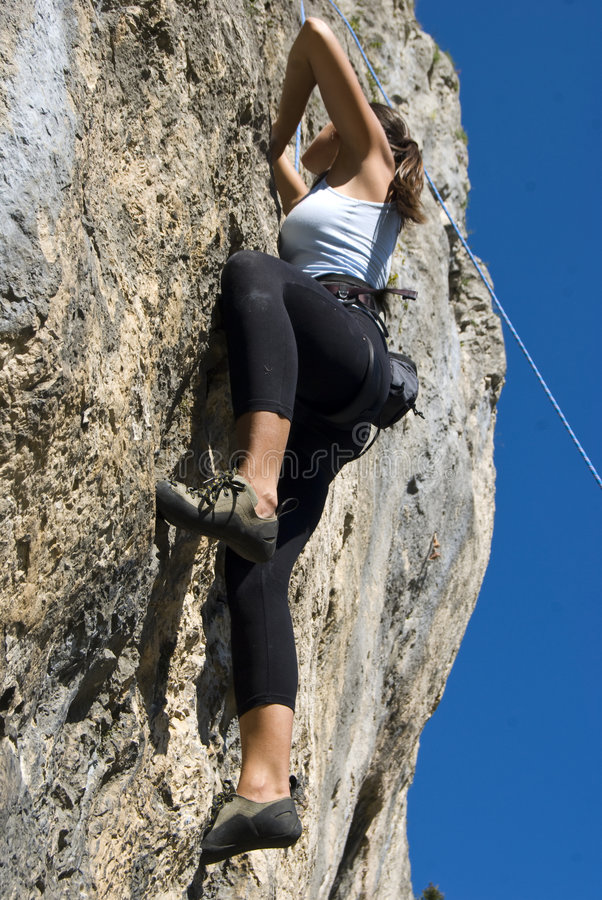 girl rock climbing in Brasov, romania royalty free stock images