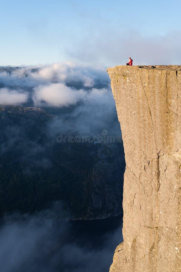 Girl on the Rock Preikestolen, Norway stock photo