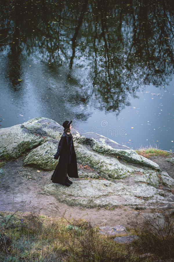 Girl on the rocks, view from above royalty free stock photos