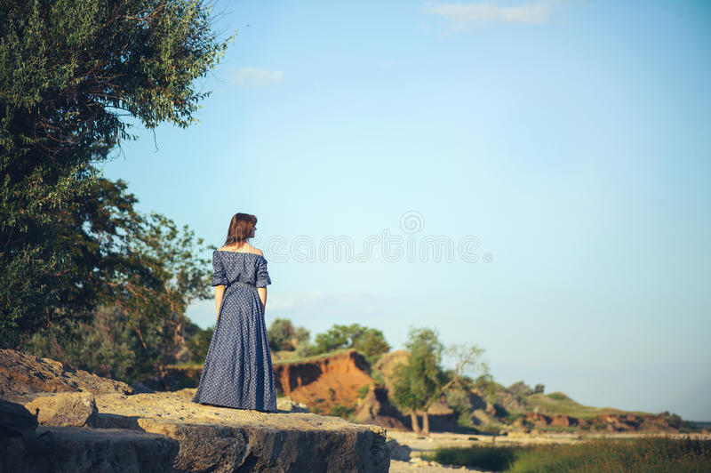 The girl on the rocky shore royalty free stock photos