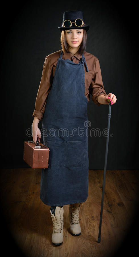 The girl in a role of handicraftsman. royalty free stock image