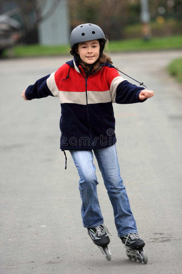 Girl on rollerblades stock photos