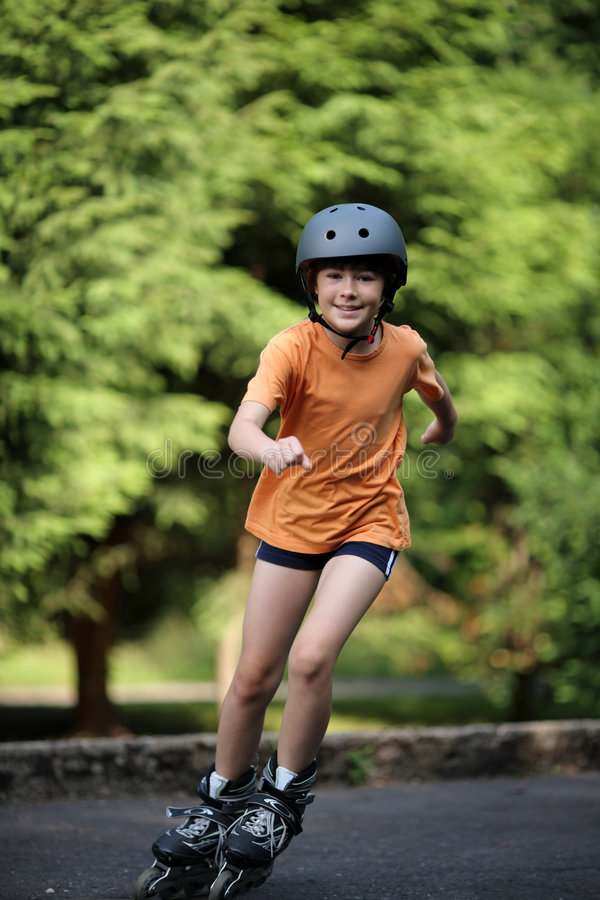 Girl on rollerblades royalty free stock photo
