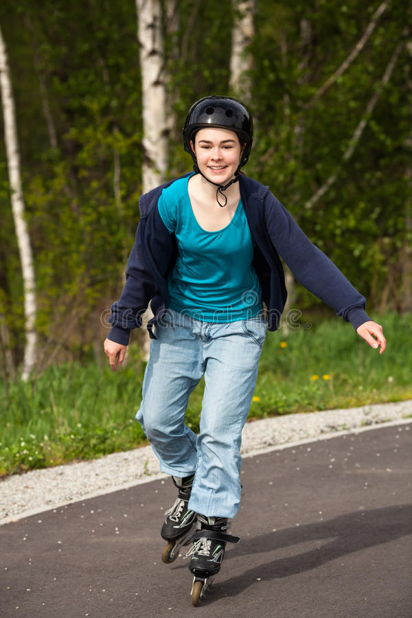 Girl on rollerblades stock photography