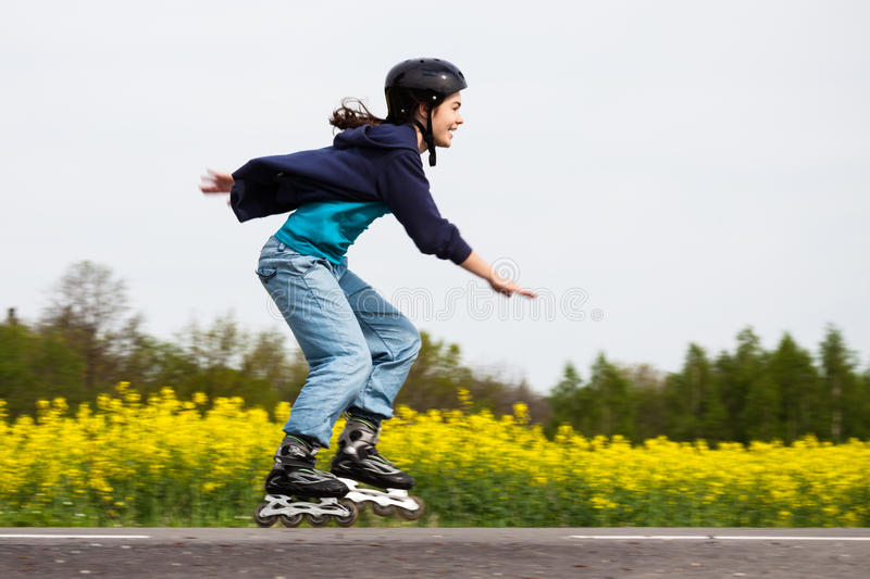 Girl on rollerblades royalty free stock photography