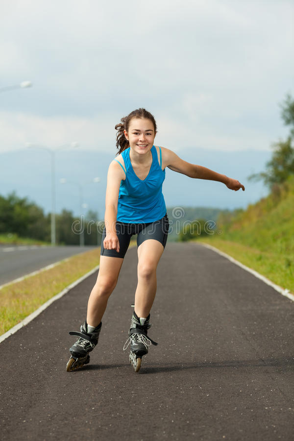 Girl on rollerblades stock images
