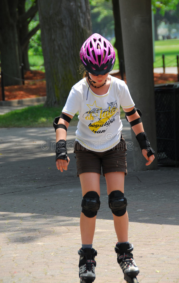 Girl rollerblading stock photos