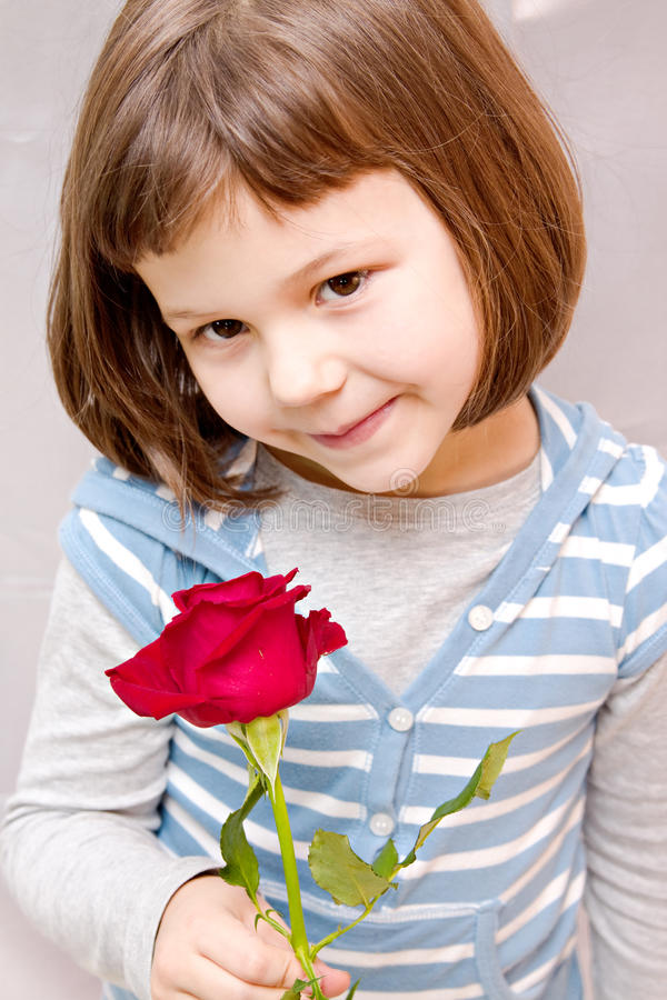 Girl with a rose royalty free stock image