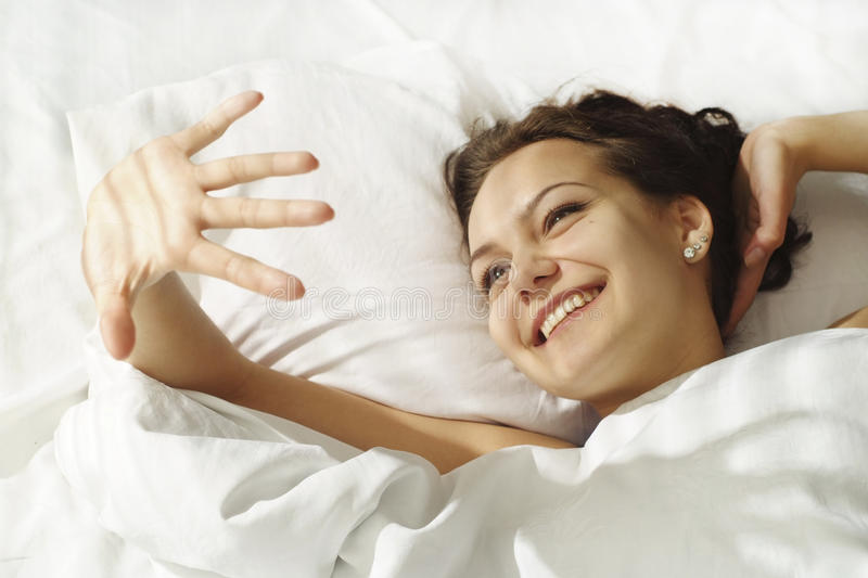 The girl rose from the hand of the sun. While lying in bed stock image